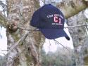 Cox Excalibur Red Brangus cap on a tree branch